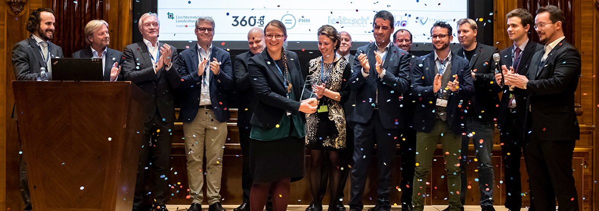 Fiona receiving the trophy for Digital Health Champion 2018, while sponsors, jury members and startup finalists are congratulating.
